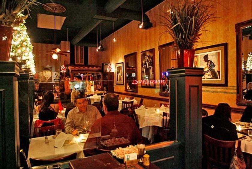 On weekend nights there's live tango music at family-run Argentine restaurant Carlitos Gardel.