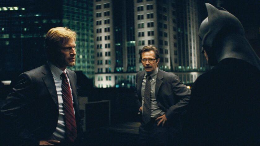 AARON ECKHART stars as Harvey Dent, GARY OLDMAN stars as Lieut. James Gordon and CHRISTIAN BALE star