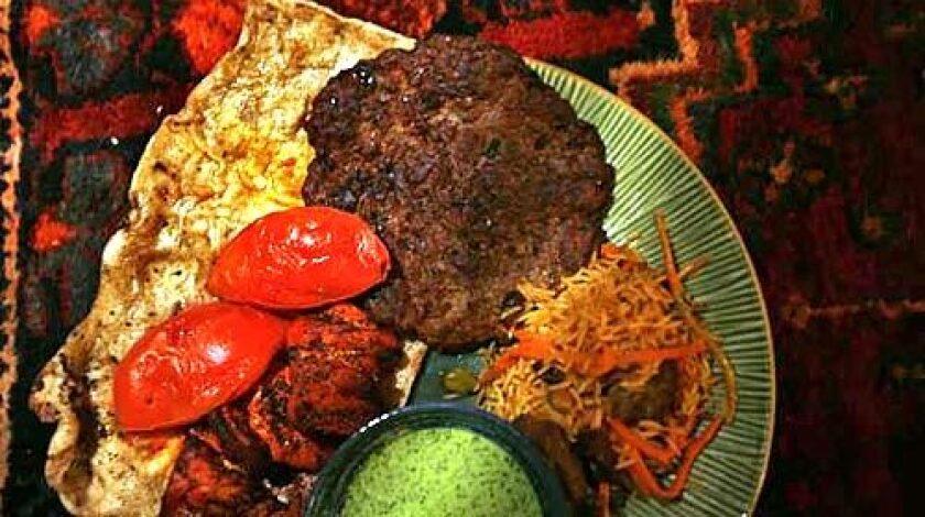 AFGHAN: Chaplee beef kebab with traditional nan bread.