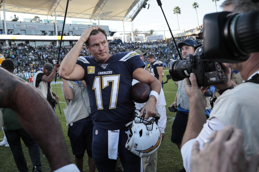 Chargers quarterback Philip Rivers exits the field after a 26-11 home victory over the Green Bay Packers last week.