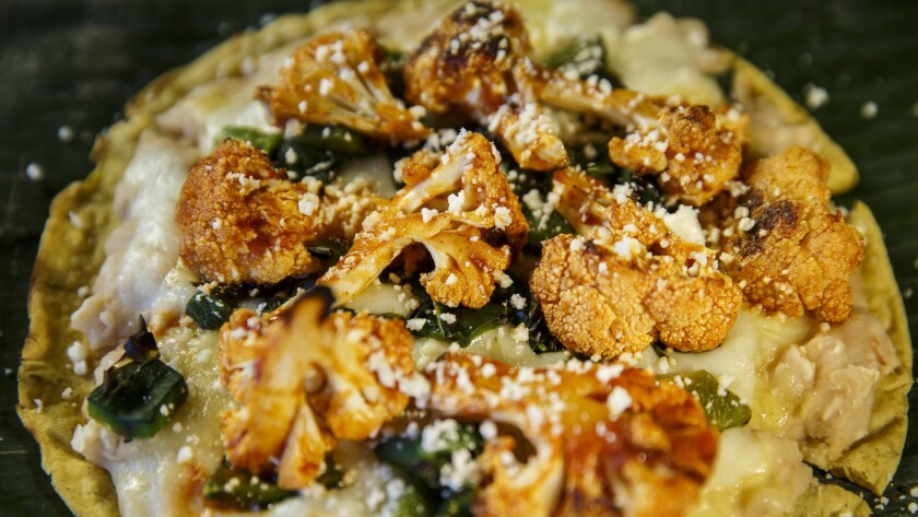 """""""Tlayuda de Cauliflower y Pasillas,"""" with Arbol white beans, guajillo roasted cauliflower, charred pasilla peppers and melted oaxacan cheese, by chef Eddie Garcia at Cocina Condesa."""