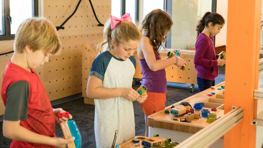 On the museum's second floor, kids can build a race car and send it flying on a track.