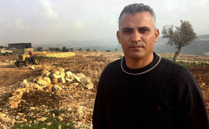"""West Bank farmer turned filmmaker Emad Burnat, 41, near the village of Bilin in the West Bank. His movie """"5 Broken Cameras"""" is nominated for an Oscar in the documentaries category."""