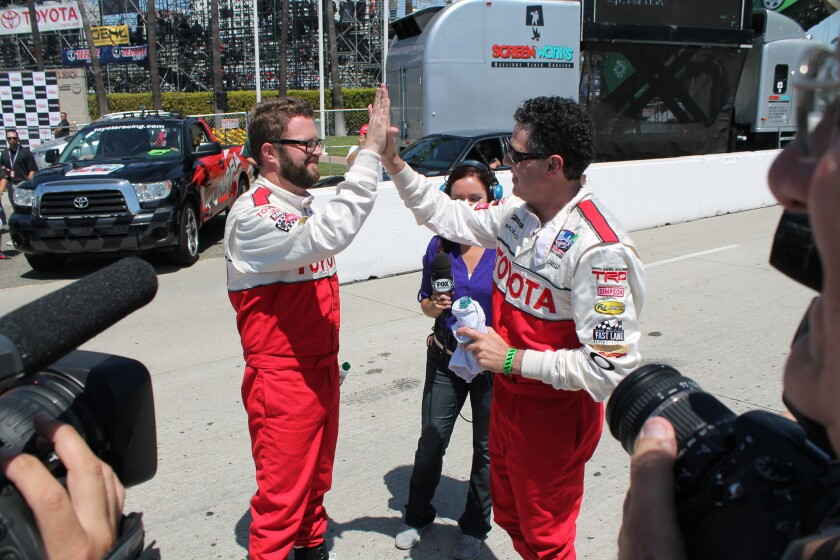 Rutledge Wood, left, and Adam Carolla celebrate after winning their respective classes in the Toyota Pro/Celebrity race at the 2013 Long Beach Grand Prix.