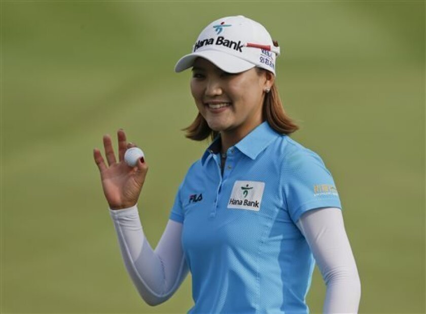 So Yeon Ryu, of South Korea, waves after saving par on the 16th hole during the final round of the LPGA Kraft Nabisco Championship golf tournament in Rancho Mirage, Calif. Sunday, April 7, 2013. (AP Photo/Chris Carlson)