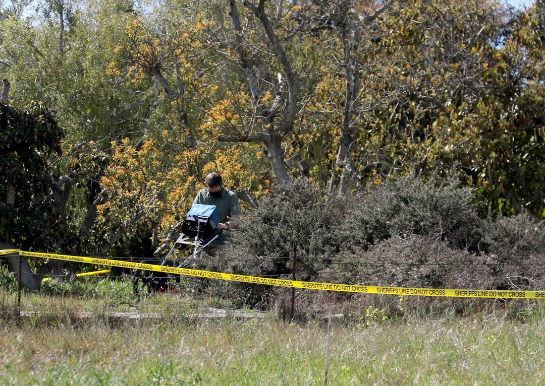San Luis Obispo Sheriff uses a ground penetrating radar to search for the body of Kristen Smart in the yard of Ruben Flores.