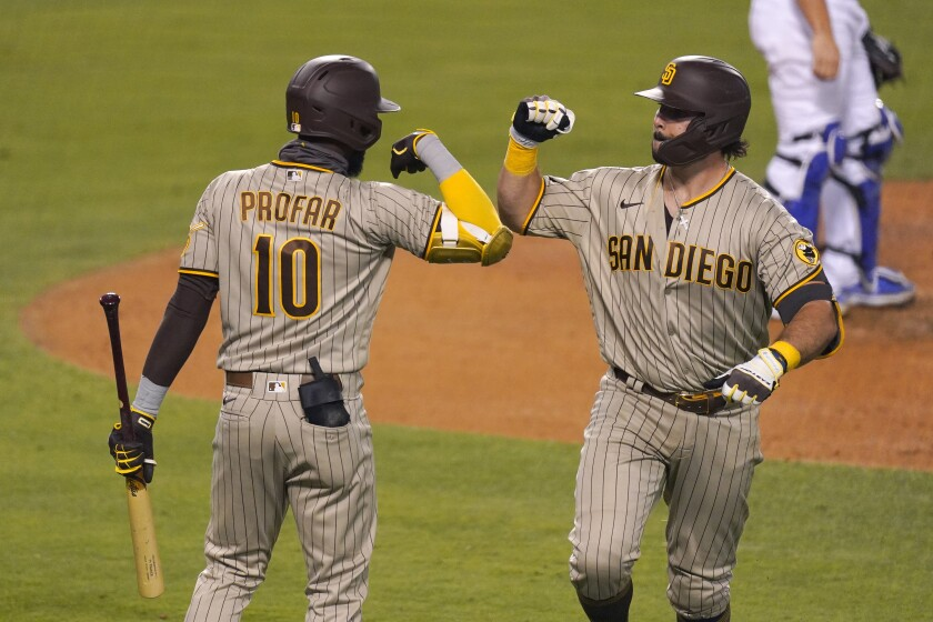 Padres catcher Austin Hedges, right, is congratulated by Jurickson Profar after home run in fifth inning Monday.