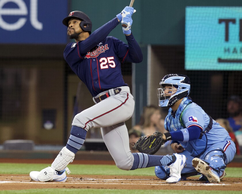 FILE - In this June 20, 2021, file photo, Minnesota Twins Byron Buxton (25) hits a home run in the first inning against the Texas Rangers during a baseball game in Arlington, Texas. Buxton does not have a new contract yet. He does not have a target return date from his current injury, either. The Twins center fielder says he still has a strong desire to remain with the organization, however. (AP Photo/Richard W. Rodriguez, File)
