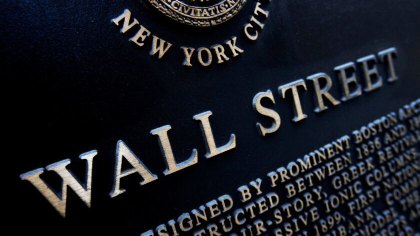 FILE - This Jan. 4, 2010, file photo shows an historic marker on Wall Street in New York. The U.S. s
