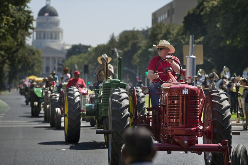 A parade of vintage tractors makes its way up Capitol Mall on Sept. 12 as Sacramento celebrated its Farm-to-Fork Festival.