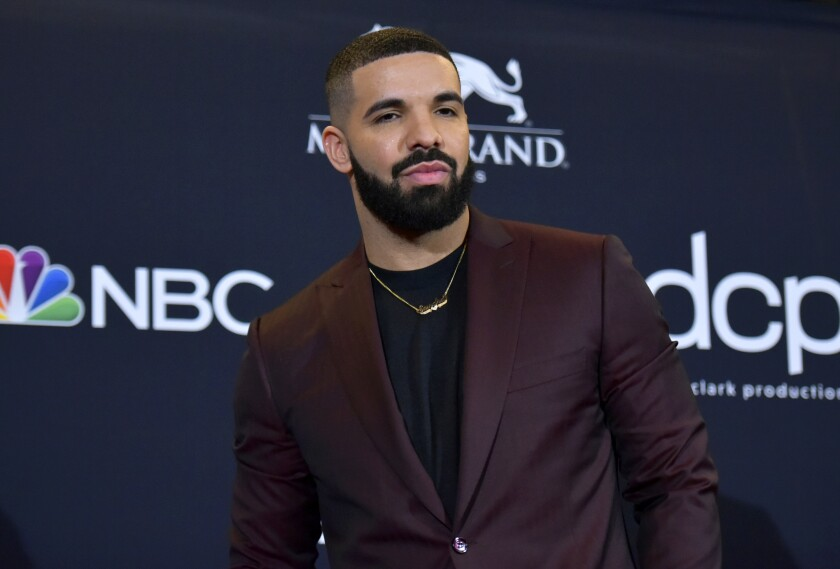 """FILE - This May 1, 2019 file photo shows Drake at the Billboard Music Awards in Las Vegas. Earning his 21st No. 1 hit on Billboard's R&B/Hip-Hop songs chart, Drake has bested a record previously held by icons Aretha Franklin and Stevie Wonder. Drake's """"Laugh Now Cry Later,"""" featuring rapper Lil Durk, reached the No. 1 spot on the chart this week. Wonder and Franklin, who died in 2018, each have had 20 songs top the chart. (Photo by Richard Shotwell/Invision/AP, File)"""