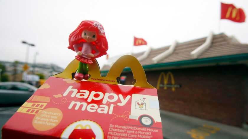 A Happy Meal box and toy are shown outside of a McDonald's restaurant in San Francisco on Oct. 1, 2010.
