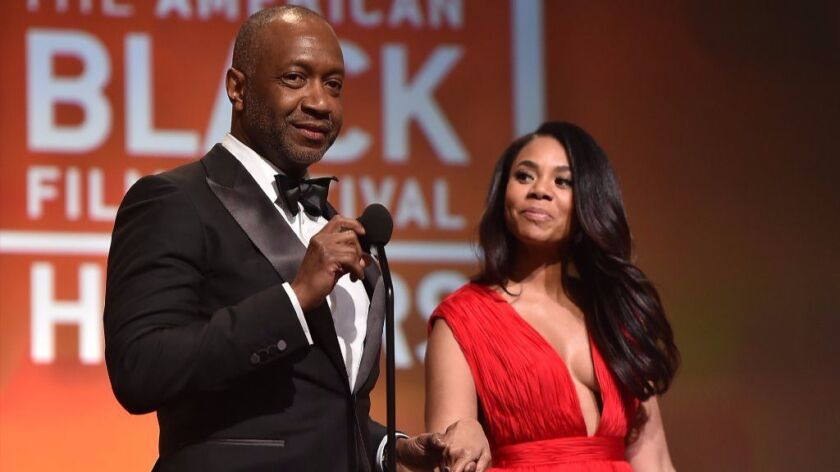 Jeff Friday, left, and Regina Hall