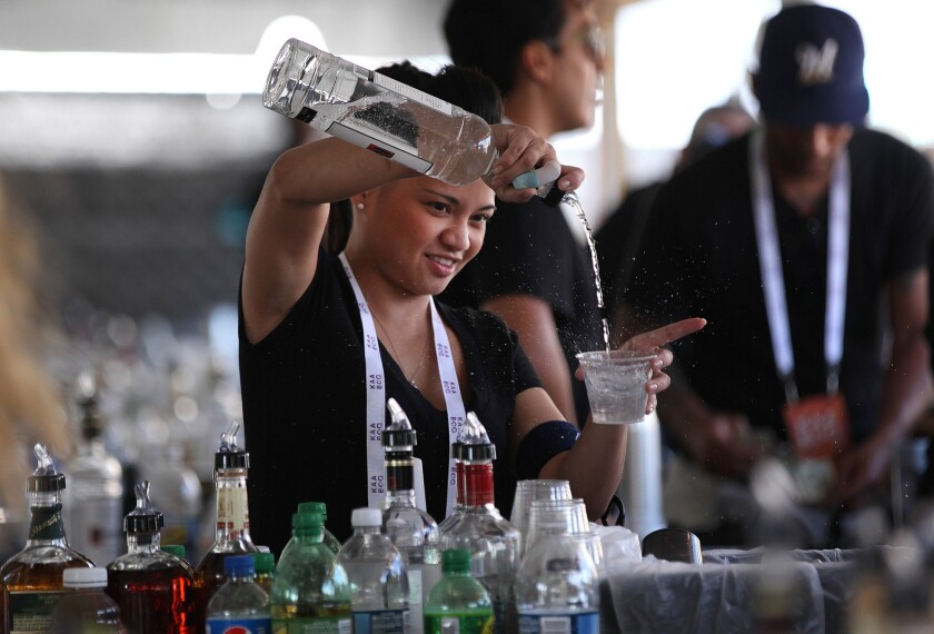 Bartender Lorie Black serves a drink at KAABOO Del Mar.