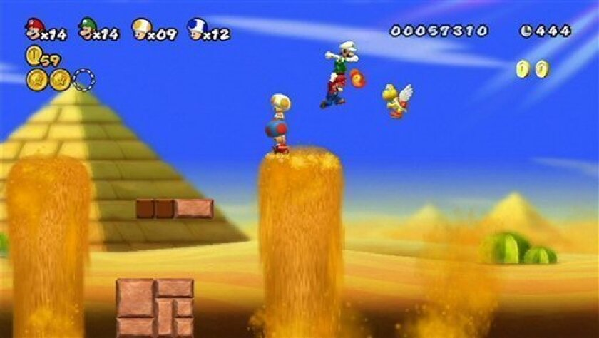 "FILE - This file screen grab released by Nintendo shows multiplayer gameplay in ""New Super Mario Bros."" for the Nintendo Wii. (AP Photo/Nintendo, File)"