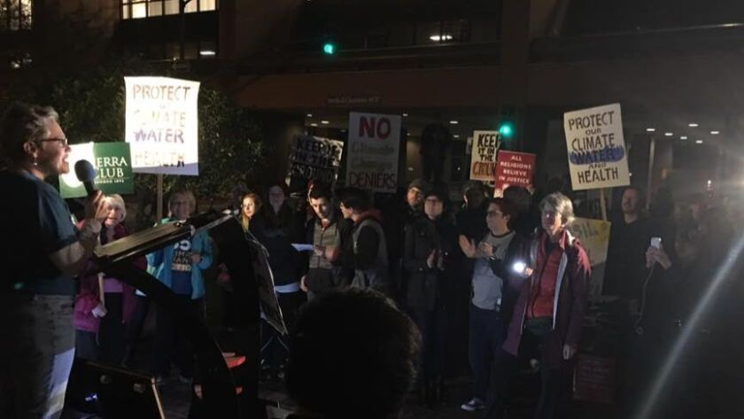 Environmental groups held a rally Monday night in downtown San Diego to oppose some of President-elect Donald Trump's Cabinet appointments.