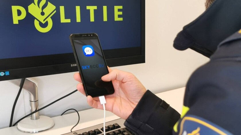 Police in the Netherlands on March 9, 2021, show a phone seized on during an investigation into SKY ECC.