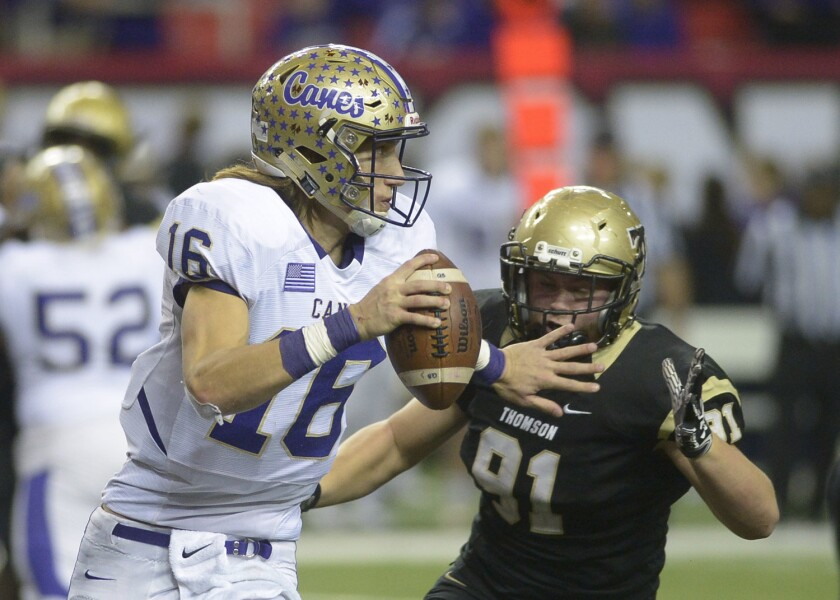 Cartersville quarterback Trevor Lawrence (16) is pressured by Thomas' Will Roberts (91) during a Class AAAA championship football game in Atlanta on Dec. 10, 2016.