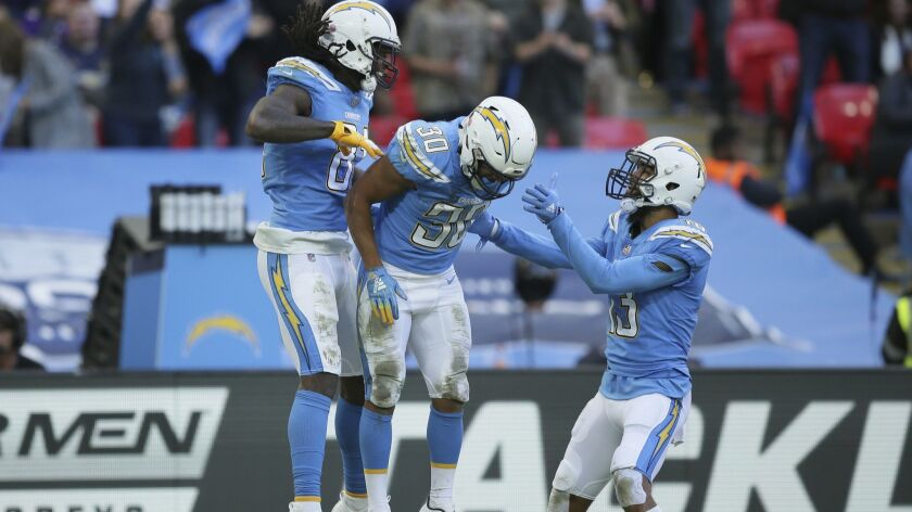 Los Angeles Chargers wide receiver Mike Williams (81) celebrates with Los Angeles Chargers running b