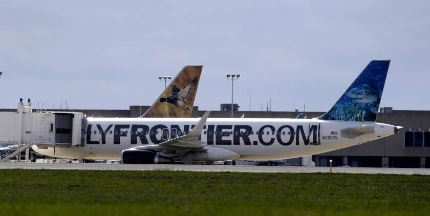 The Frontier Airlines plane that Amber Vinson flew from Cleveland to Dallas on Monday, rests at a terminal at Cleveland Hopkins International Airport, Wednesday, Oct. 15. The carrier is working with federal health officials to contact passengers who flew with an Ebola-stricken healthcare worker this week.