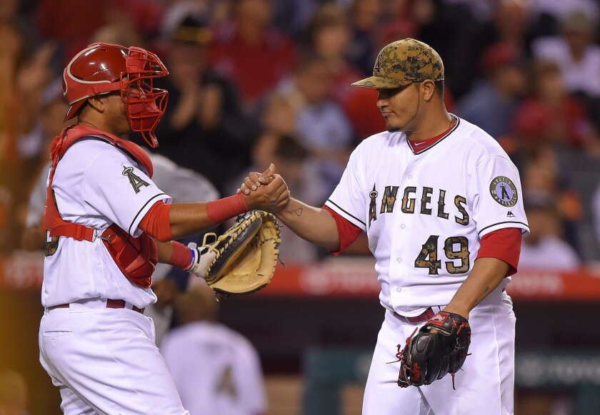 Los Angeles Angels starting pitcher Jhoulys Chacin, right, is congratulated by catcher Carlos Perez after the Angels defeated the Detroit Tigers 5-1 in a baseball game, Monday, May 30, 2016, in Anaheim, Calif. (AP Photo/Mark J. Terrill)