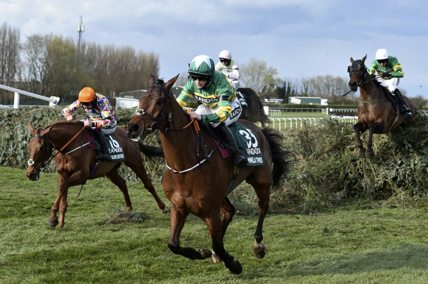 Rachael Blackmore ridding Minella Times clears the last fence to win the Randox Grand National Handicap Chase on the third day of the Grand National Horse Racing meeting at Aintree racecourse, near Liverpool, England, Saturday April 10, 2021. (Peter Powell/Pool via AP)