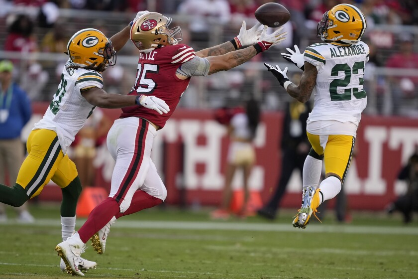 Green Bay Packers cornerback Jaire Alexander (23) intercepts a pass intended for San Francisco 49ers tight end George Kittle, middle, during the first half of an NFL football game in Santa Clara, Calif., Sunday, Sept. 26, 2021. (AP Photo/Tony Avelar)