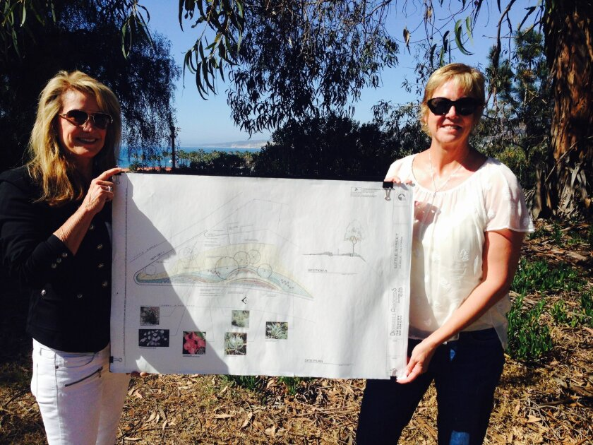 LJSA members Susan Tschirn and Angie Preisendorfer display plans for the restoration of Little Park.
