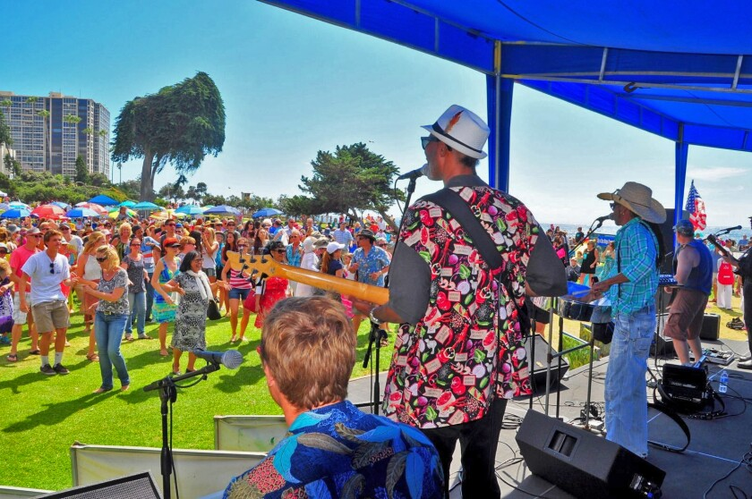 Crowds groove to cajun-blues tunes from Theo and The Zydeco Patrol during a previous La Jolla Concerts by the Sea event at Scripps Park in La Jolla Cove. The free music series will return in summer 2020 after a three-year absence.
