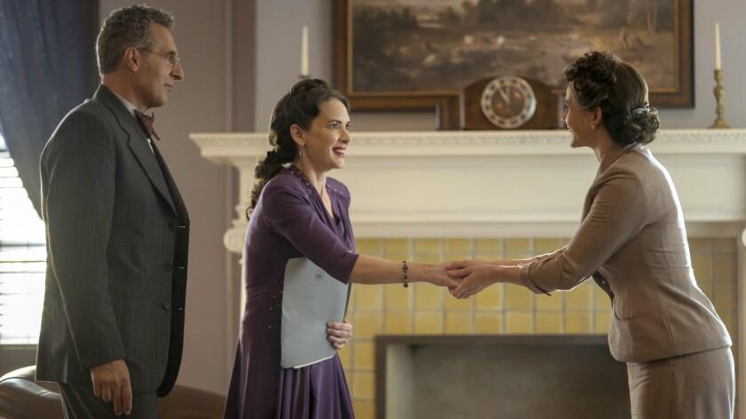 "John Turturro, left, Winona Ryder and Caroline Kaplan in ""The Plot Against America"" on HBO."