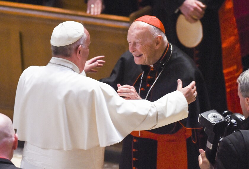 Pope Francis reaches out to hug Cardinal Archbishop Emeritus Theodore McCarrick in Washington in September 2015.