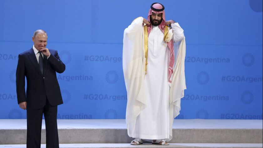 Crown Prince Mohammed bin Salman waits for the G-20 group photo in Buenos Aires in November 2018, with only Russian President Vladimir Putin near him. It was the Saudi prince's first major overseas appearance since the killing of a dissident journalist who lived in the U.S.