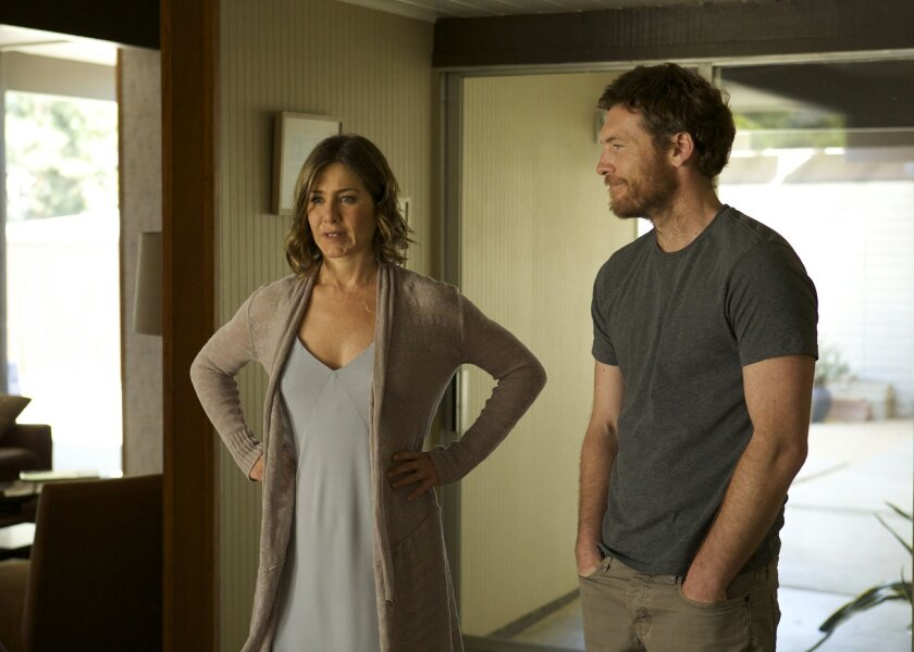 """This image released by Cinelou Films shows Jennifer Aniston, left, and Sam Worthington in a scene from """"Cake."""" (AP Photo/Cinelou Films, Tony Rivetti Jr.)"""