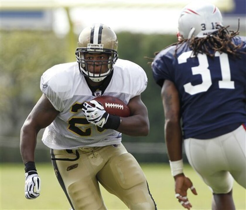 New Orleans Saints running back Pierre Thomas runs past New England Patriots' Brandon Meriweather (31) during a joint football practice in Foxborough, Mass. Tuesday, Aug. 10, 2010. (AP Photo/Winslow Townson)