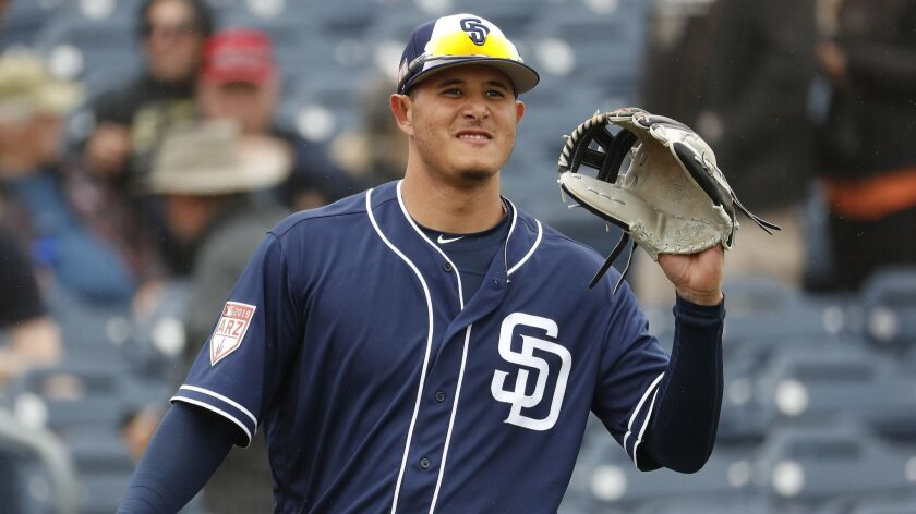 Padres third baseman Manny Machado warms up prior to his first spring training game Saturday against the Giants.