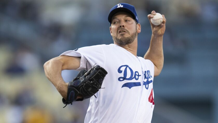 Los Angeles Dodgers starting pitcher Rich Hill throws during the first inning of the team's baseball