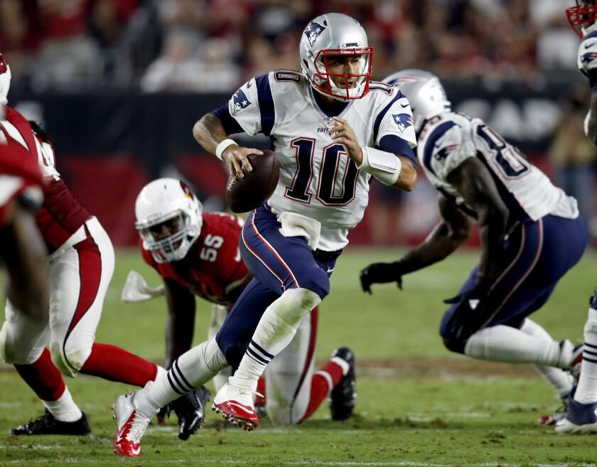 Patriots quarterback Jimmy Garoppolo (10) scrambles against the Arizona Cardinals during the second half.