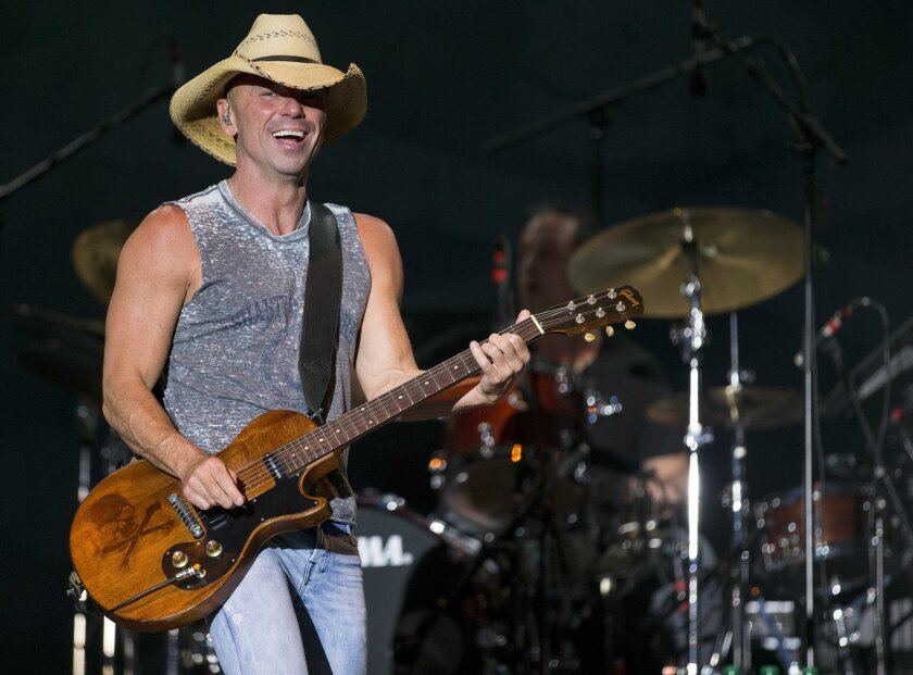 FILE - In this April 3, 2016 file photo, Kenny Chesney performs at the 4th Annual ACM Party for a Cause Festival in Las Vegas. hesney will headline a concert at Bristol Motor Speedway on Sept. 9, the night before the speedway hosts a football game between Tennessee and Virginia Tech. (Photo by Eric