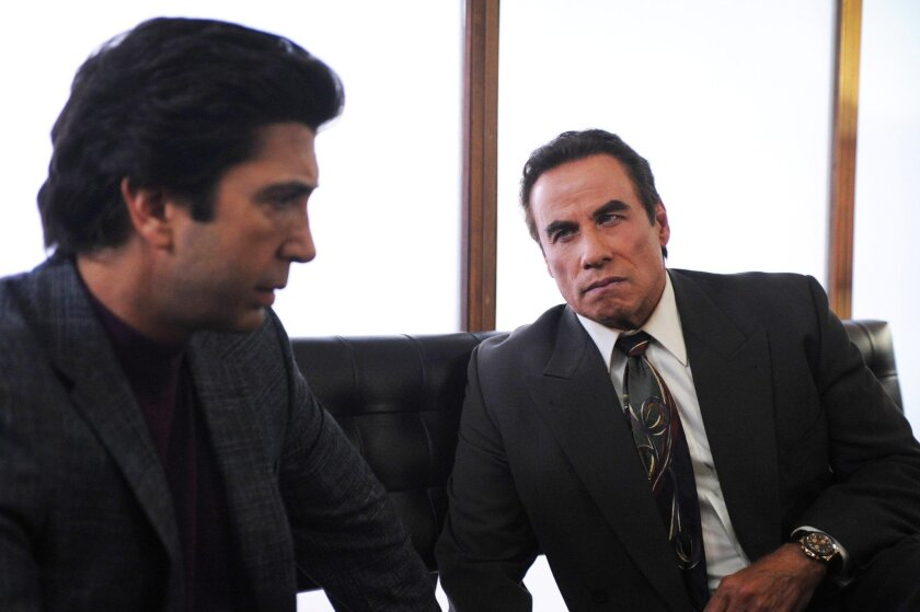 "In this image released by FX, David Schwimmer portrays Robert Kardashian, left, and John Travolta portrays Robert Shapiro, in a scene from ""The People v. O.J. Simpson: American Crime Story."""