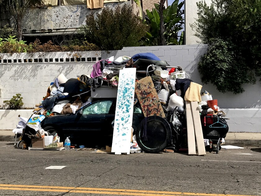 A car is heaped with belongings on Pacific Avenue in Venice.