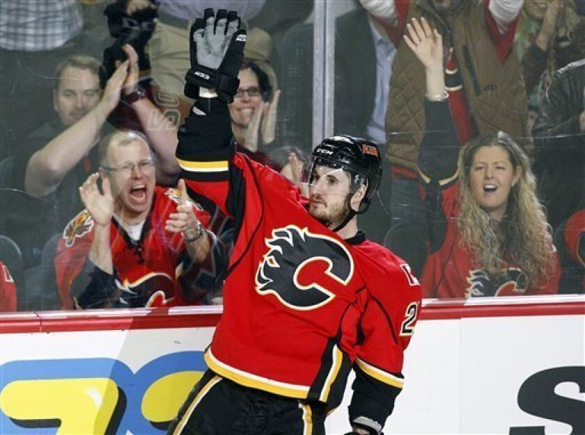 Calgary Flames' Curtis Glencross celebrates his goal during third period NHL hockey action against the Detroit Red Wings in Calgary, Alberta, Wednesday, March 13, 2013. (AP Photo/The Canadian Press, Jeff McIntosh)