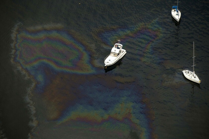 Boats amid an oil slick in Guanabara Bay where the sailing competitions at the 2016 Rio Olympic Games will be held on May 21.