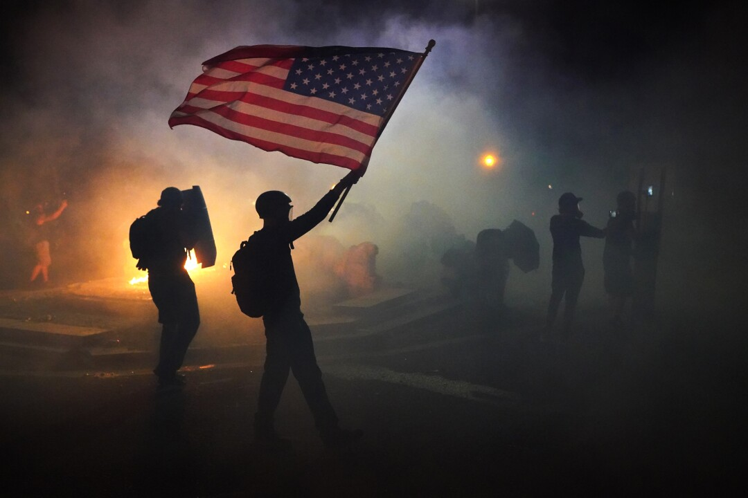 A protester waves an American flag.