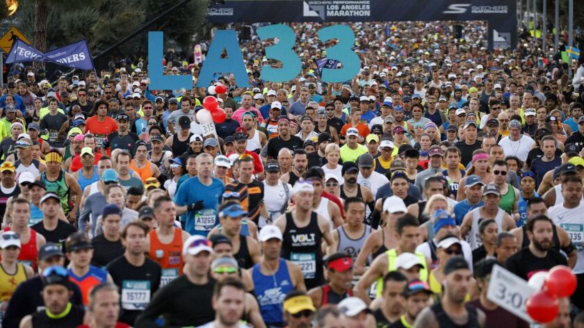 Runners start the 33rd annual L.A. Marathon at Dodger Stadium on Sunday, March 18, 2018 in Los Angel