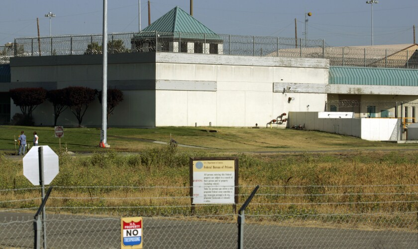 FILE - In this July 20, 2006, file photo, the Federal Correctional Institution in Dublin, Calif. Federal investigators have questioned the warden of the federal women's prison in California and searched his office. It comes weeks after a former correctional officer at the facility was arrested on charges of sexually abusing inmates. It wasn't immediately clear if the search at the Federal Correctional Institution at Dublin was connected to last month's arrest. (AP Photo/Ben Margot, File)