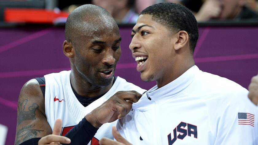 Lakers star Kobe Bryant, left, and New Orleans Pelicans forward Anthony Davis talk while sitting on the bench during a game at the 2012 London Olympics.