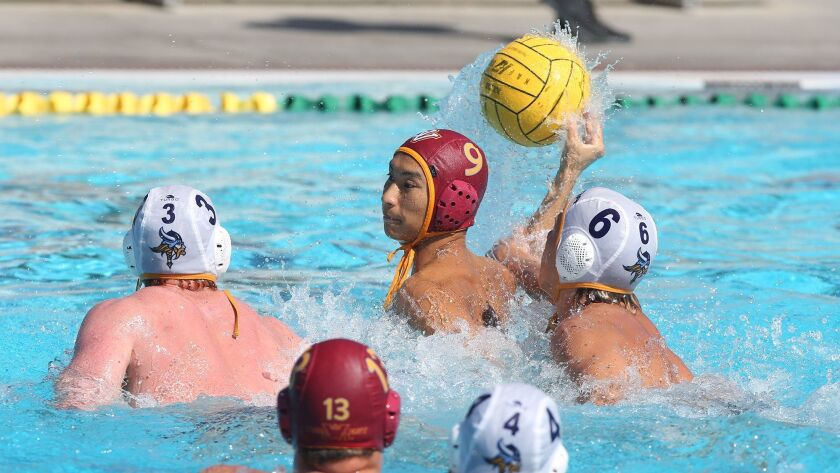 Ocean View High's Daniel Isogawa has the ball knocked free by Marina High's Sam Capifoni, as he atte