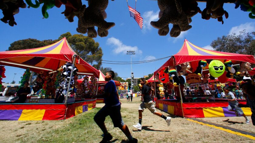 Carnival fans take part in the 5-day carnival held in National City's Kimball Park ahead of the 2017 Fourth of July.