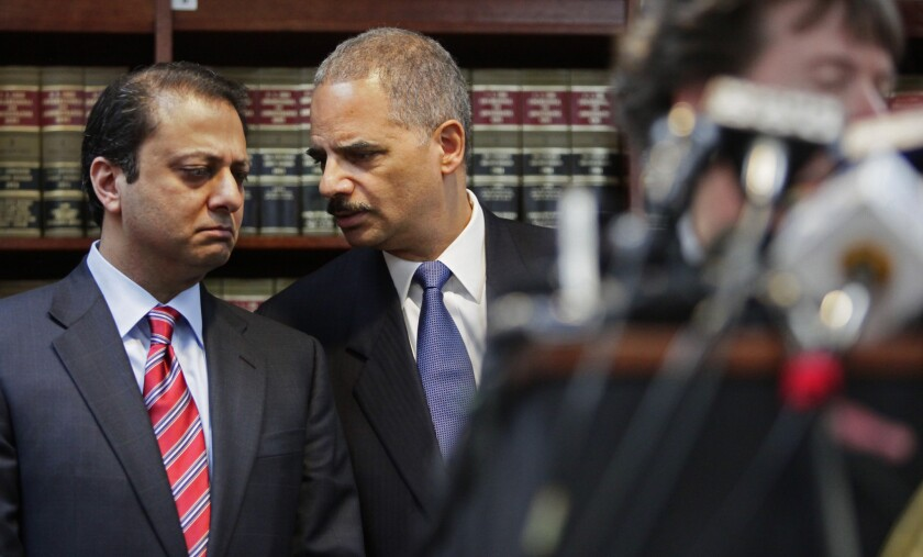 "U.S. Attorney for New York's Southern District Preet Bharara confers with U.S. Attorney General Eric Holder at a news conference in 2011. Bharara sent a federal grand jury subpoena to Reason.com demanding ""all identifying information"" about six anonymous users who posted comments on the site."