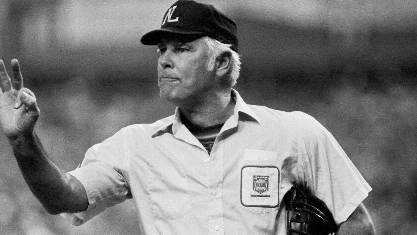 FILE- In this Oct. 11, 1980, file photo, plate umpire Doug Harvey gestures before play resumes in th